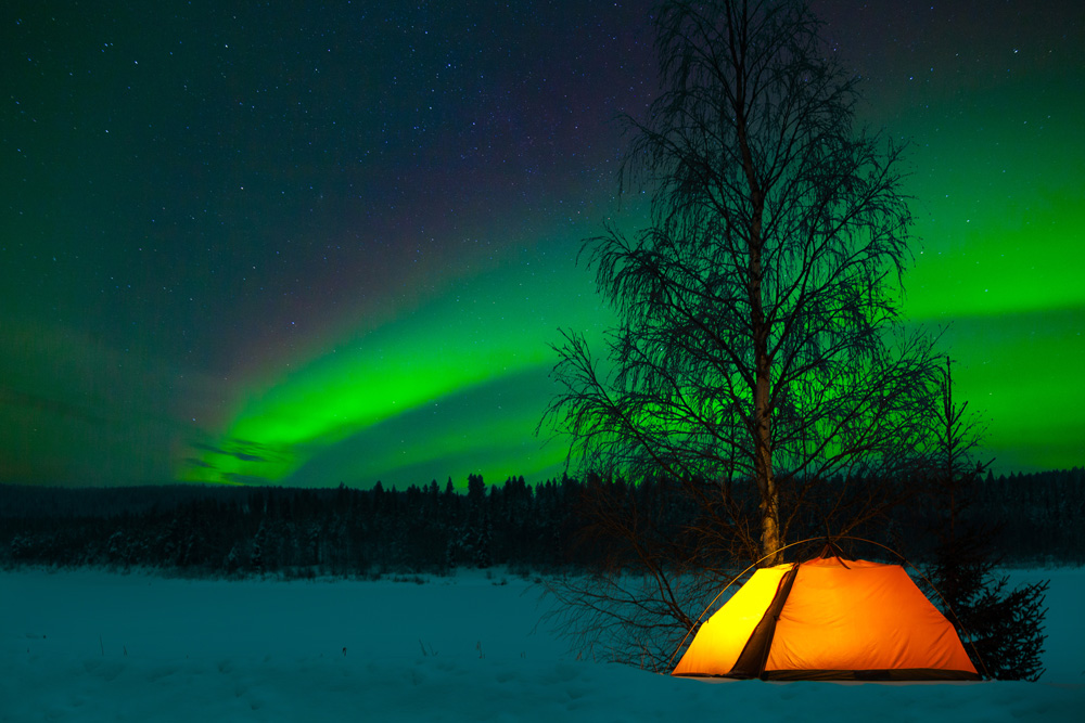 Camping in the Arctic under the Northern lights